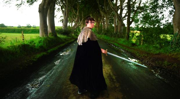 A Game of Thrones fan visits a tree lined road known as The Dark Hedges on August 13, 2015 in Belfast, Northern Ireland (Photo by Charles McQuillan/Getty Images)