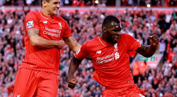 Liverpool's Christian Benteke (right) celebrates scoring his side's first goal of the game during the Barclays Premier League match at Anfield, Liverpool. Photo: Peter Byrne/PA