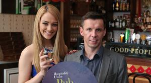Cheers: Sunday Life editor Martin Breen and model Ashleigh Coyle.