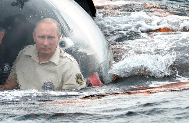 Russian President Vladimir Putin submerges on board C-Explorer 3 bathyscaphe into the waters of the Black Sea outside Sevastopol on August 18, 2015, to explore sunken shipwrecks. AFP/Getty Images