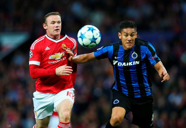 Wayne Rooney of Manchester United is held off by Oscar Duarte of Club Brugge during the UEFA Champions League Qualifying Round Play Off First Leg match between Manchester United and Club Brugge at Old Trafford on August 18, 2015 in Manchester, England. (Photo by Alex Livesey/Getty Images)
