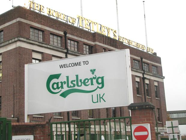 Beer giant Carlsberg said UK beer sales slumped in the first six months of the year as the group warned that full-year profits would be lower than expected
