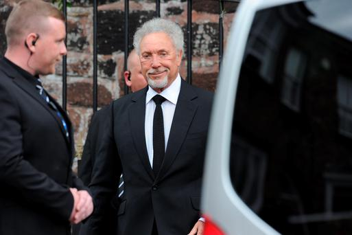 Sir Tom Jones arrives for the funeral of Cilla Black at St Mary's Church in Woolton, Liverpool.