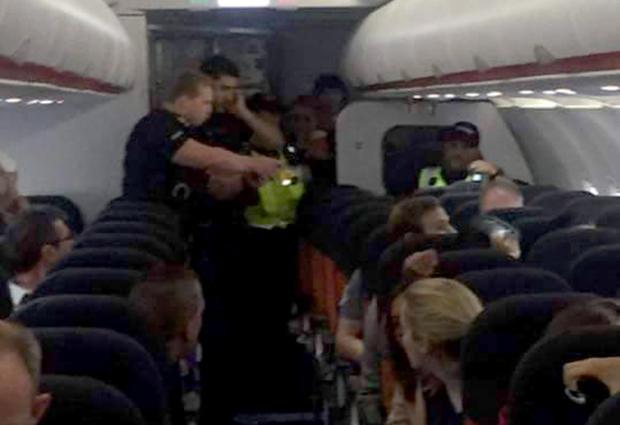 Man is in police custody after being tasered on an aircraft. Picture credit: Marty Wylie
