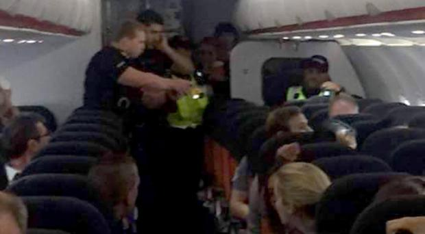 Man is in police custody after being tasered on an aircraft