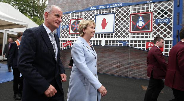 Mary McAleese and her husband Martin walk past an Orange Arch at The Grand Orange Order Lodge of Ireland's new interpretative centre in east Belfast. Brian Little/Presseye