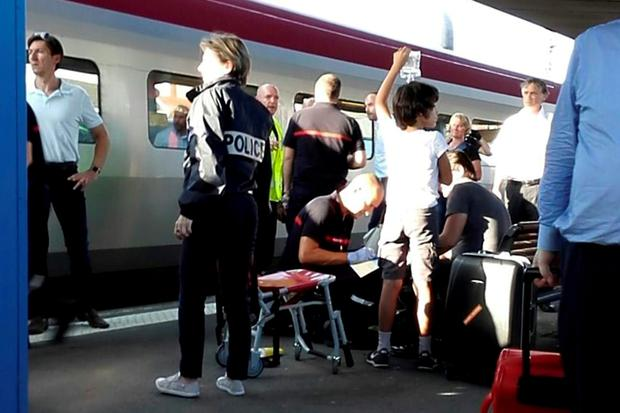 A passenger receives first aid on the platform at Arras after last night's shooting