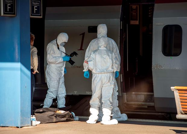 French forensics police officers wearing protective suits inspect the crime scene in a Thalys train of French national railway operator SNCF at the main train station in Arras, northern France, on August 22, 2015, a day after an armed gunman on the train was overpowered by passengers. AFP/Getty Images