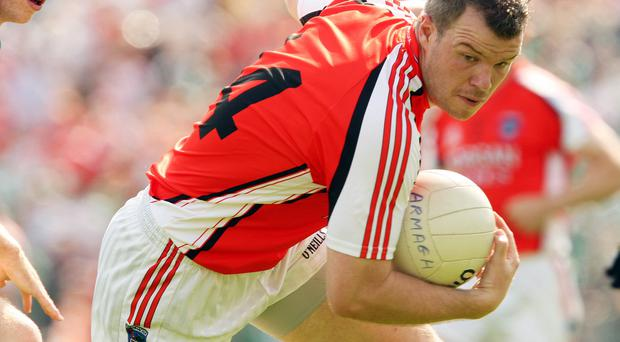 Ronan in action for Armagh during the 2008 Ulster Senior Football Championship Final replay. ©INPHO/Cathal Noonan.