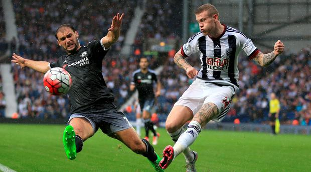 Chelsea's Branislav Ivanovic and West Bromwich Albion's James McClean (right) battle for the ball during the Barclays Premier League match at The Hawthorns, West Bromwich. Nick Potts/PA Wire.