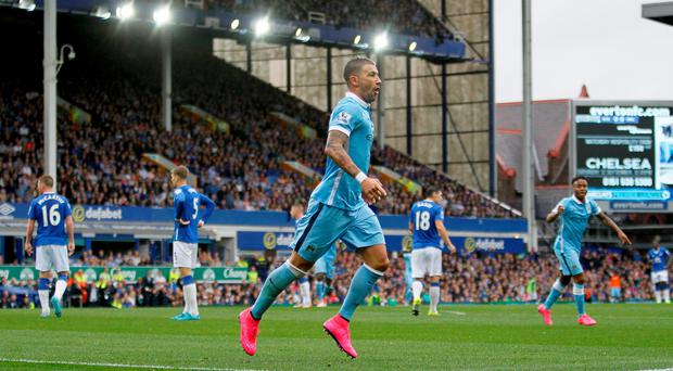 Manchester City's Aleksandar Kolarov celebrates scoring his side's first goal of the game during the Barclays Premier League match at Goodison Park, Liverpool. Richard Sellers/PA Wire.