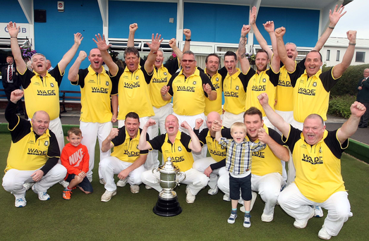 Victory roar: Dunbarton celebrate clinching the IBA Senior Cup, their second trophy in the space of three days