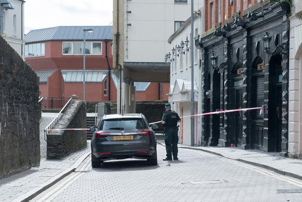 A police officer at the scene in Bank Place in Derry where an investigation is underway into the death of 25-year-old Conall Kerrigan on Sunday night. Picture Martin McKeown. Inpresspics.com 24.08.15