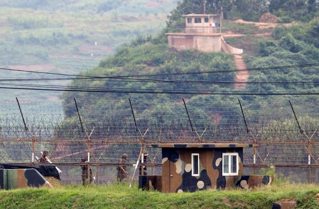 South Korean (bottom) and North Korean (top) guard posts are seen on either side of the Demilitarized Zone (DMZ) between North and South Korea in Paju on August 24, 2015. South Korea's president hardened her line with North Korea on August 24, demanding an unequivocal apology for recent provocations as the two rivals struggled to negotiate their way out of a dangerous military standoff. AFP/Getty Images