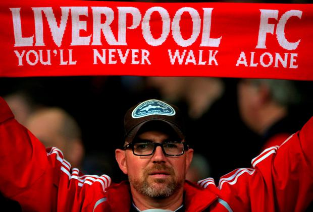 A Liverpool fan shows his support in the stands during the Barclays Premier League match at the Emirates Stadium, London. Monday August 24, 2015. Photo: Nick Potts/PA