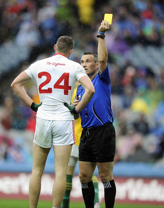 Ref justice: Referee Maurice Deegan shows a yellow card to Tyrone's Padraig McNulty at Croke Park on Sunday