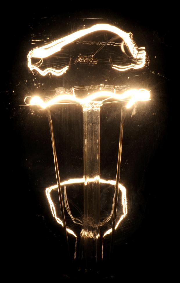 The new lights use around half as much electricity as a conventional streetlight and last almost three times longer. Pictured is an old style of lightbulb