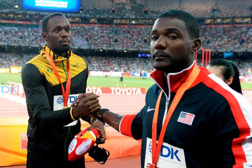 Shake on it: Usain Bolt beat Justin Gatlin to the 100m title and he's warned the American he wants 200m glory as well