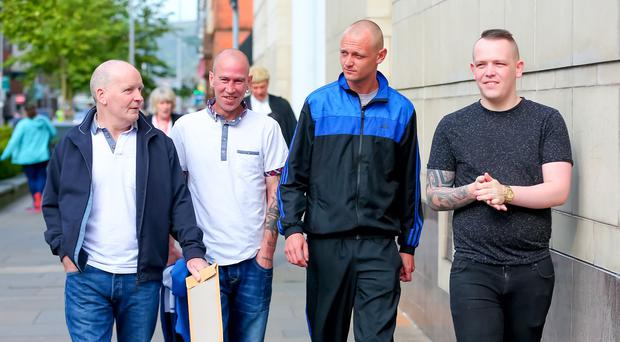 Pride of Ardoyne Flute band members Robert (Bobby) Hayes Spence (57), David John Murphy (38), James Cosby (26), and Gary Edwin Wells (24), arrive at Belfast Magistrates' Court where they were sentenced for playing music at the Interface of Twaddell and Ardoyne. Pic Kevin Scott