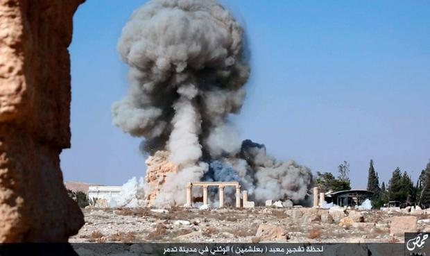 Smoke from the detonation of the 2,000-year-old temple of Baalshamin in Syria's ancient caravan city of Palmyra. Photo released Aug. 25, 2015 (Islamic State social media account via AP)