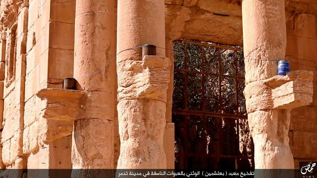 An undated image published by Isis group in the Homs province (Welayat Homs) on August 25, 2015, allegedly shows explosives placed on parts of columns of the Baal Shamin temple in Syria's ancient city of Palmyra. AFP/Getty Images
