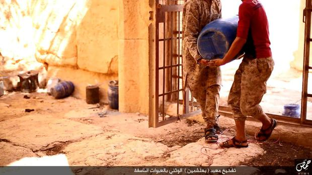 An undated image, which appears to be a screenshot from a video and which was published by the Islamic State group in the Homs province (Welayat Homs) on August 25, 2015, allegedly shows Jihadists preparing explosives in the Baal Shamin temple in Syria's ancient city of Palmyra. The temple was destroyed by the extremist group and news of its demolition sparked international condemnation earlier this week. AFP/Getty Images