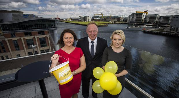 Teresa Sloan of Aware is pictured with Jason Marty, Baker & McKenzie Executive Director for Global Services Belfast and Subscriber Relationship Management Representative, Edelle McGinn launching Aware's two-year fundraising partnership