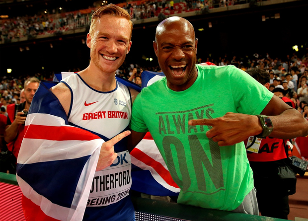 Greg Rutherford of Great Britain (L) is congratulated by Mike Powell after winning gold in the Men's Long Jump final (Photo by Andy Lyons/Getty Images)