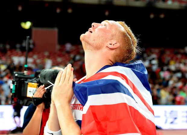 Great Britain's Greg Rutherford celebrates winning gold in the Long Jump Final during day four of the IAAF World Championships at the Beijing National Stadium, China. Photo: PA