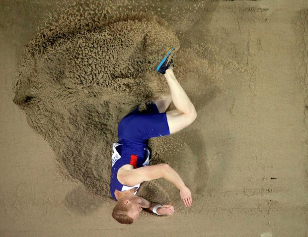 Britain's Greg Rutherford lands in the sand in the mens long jump final (AP Photo/Wong Maye-E)