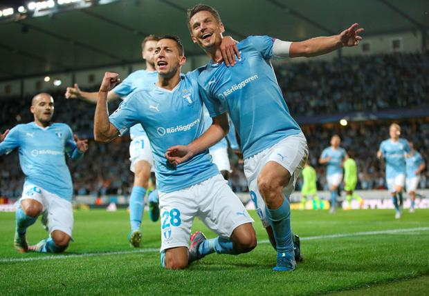 Malmo's Nikola Djurdjic, left, and Markus Rosenberg celebrate after Rosenberg scored the opening goal during the Champions League play-off second leg soccer match between Malmo FF and Celtic at Malmo New Stadium, in Malmo, Sweden, Tuesday, Aug. 25, 2015. (Andreas Hillergren/TT via AP)