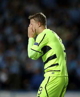 Oh no: Celtic's Leigh Griffiths sums up the mood of the night as his team crash out of Champions League, beaten 2-0 by Malmo in Sweden to be eliminated from the qualifying round 4-3 on aggregate