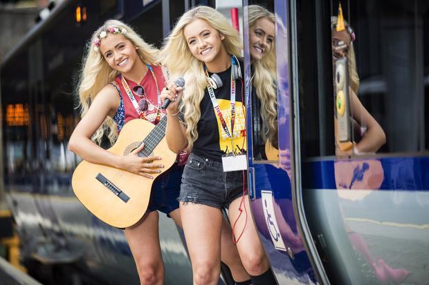 Music fans Stacey and Alannah Murray announce Translinks special coach, bus and train services for music fans travelling to see performances by Calvin Harris (29 August) and The Script (30 August) at Boucher Playing Fields in South Belfast. Picture by Brian Morrison.