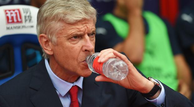 Defiant: Arsene Wenger defended his tactical approach