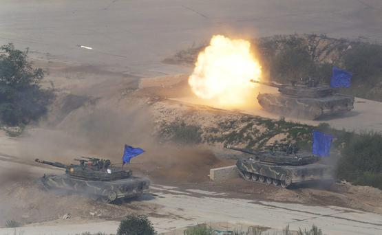South Korean army's K1A1 battle tank fires during the South Korea-U.S. joint military live-fire drills at Seungjin Fire Training Field in Pocheon, South Korea, near the border with North Korea, Friday, Aug. 28, 2015. The South Korean and U.S. soldiers held the combined live fire drill on Friday to display combined firing capabilities between South Korea and the U.S. militaries, showing that they are prepared to defend South Korea against North Korea's possible attack or provocations. (AP Photo/Ahn Young-joon)