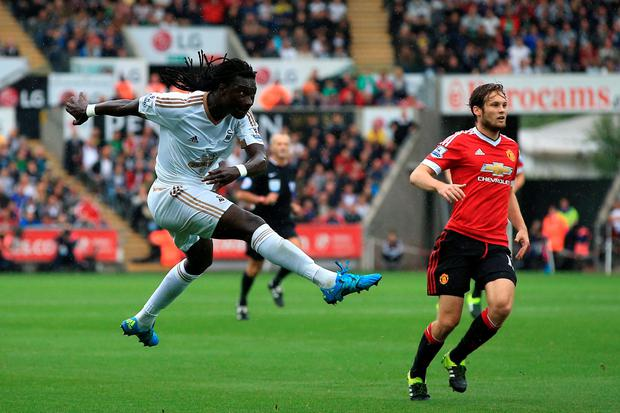 Swansea City's Bafetimbi Gomis hits a shot towards goal during the Barclays Premier League match at the Liberty Stadium, Swansea. Nick Potts/PA Wire.