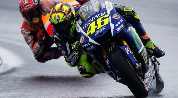 Winning line: Valentino Rossi of Italy leads Marc Marquez of Spain during the MotoGP at Silverstone