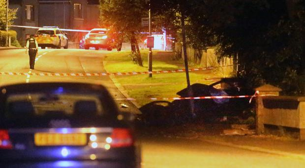 Police seal off the road after the accident in Ballymoney