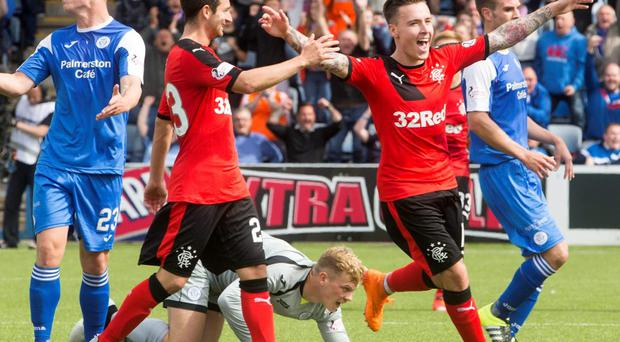 Get in: Barrie McKay celebrates scoring Rangers fourth goal against Queen of the South