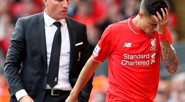 Red alert: Brendan Rodgers looks on as Philippe Coutinho is sent off