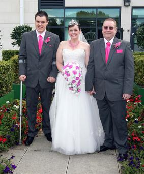 Scott Vineer with his mum Helen and her husband Paul Doney