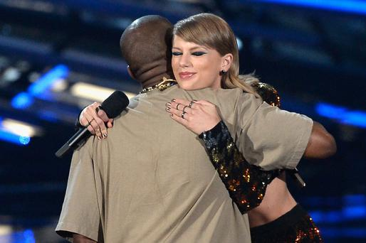 West and Taylor Swift embrace onstage. Pic: Kevork Djansezian/Getty Images