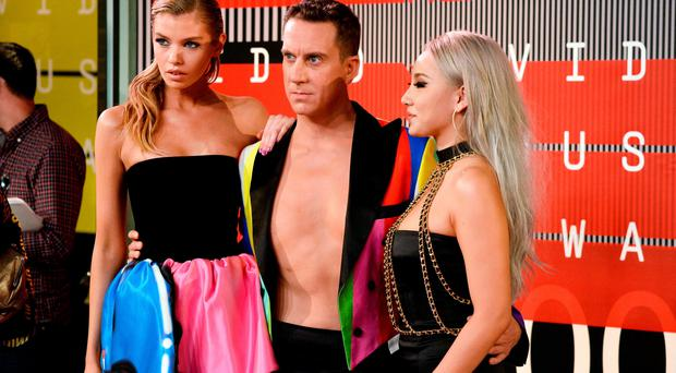 LOS ANGELES, CA - AUGUST 30: (L-R) Model Stella Maxwell, designer Jeremy Scott and Korean pop star CL attends the 2015 MTV Video Music Awards at Microsoft Theater on August 30, 2015 in Los Angeles, California. (Photo by Frazer Harrison/Getty Images)
