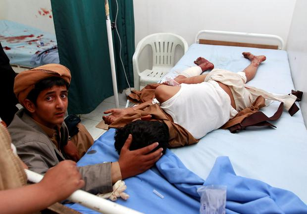 A Yemeni boy comforts an injured boy at a hospital in Sanaa after he was injured when two suicide bombers hit a mosque in the Yemeni capital in quick succession on September 2, 2015 in an attack reminiscent of previous bombings by the Islamic State group, sources told AFP. AFP/Getty Images