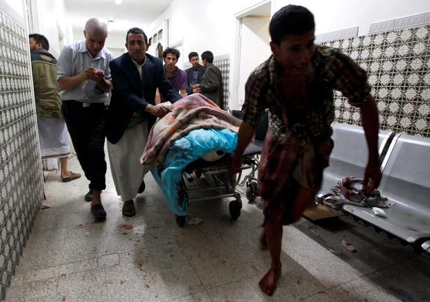Yemenis transport a severely injured man on a gurney as he arrives at a hospital in Sanaa after being injured when two suicide bombers hit a mosque in the Yemeni capital. AFP/Getty Images