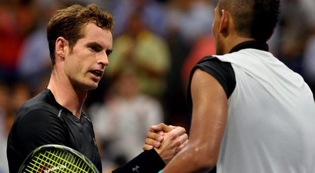 Marching on: Andy Murray embraces Nick Kyrgios after beating the Australian in four sets in the first round of the US Open