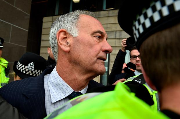 Former Rangers chief executive Charles Green leaves court surrounded by police on September 2, 2015 in Glasgow, Scotland. (Photo by Jeff J Mitchell/Getty Images)