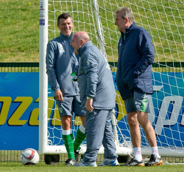 Relaxed: Roy Keane, kit man Dick Redmond and coach Steve Walford are all smiles in training