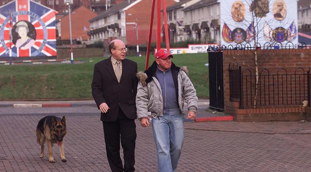 Johnny Adair with former associate John White in the heart of loyalist Belfast in 2002