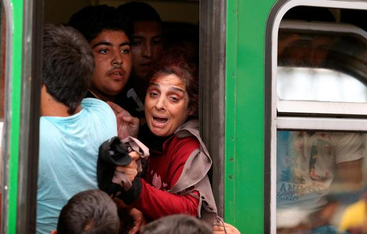 Migrants board trains in Keleti station after it was reopened this morning in central Budapest on September 3, 2015 in Budapest, Hungary.